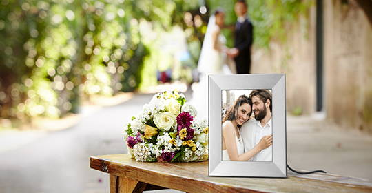 Give guests more reasons to celebrate love with Nixplay Frames pre-loaded with your favorite photos from your big day.