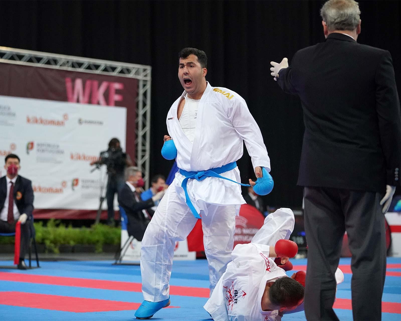 olympic karate athlete celebrates victory