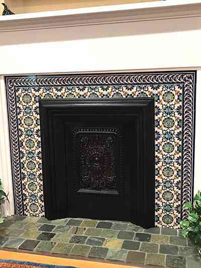 Floral colorful fireplace tile surround