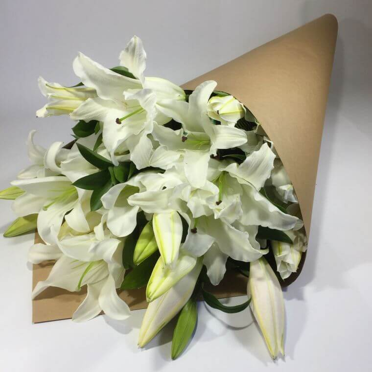 Funeral lilies being delivered to a funeral