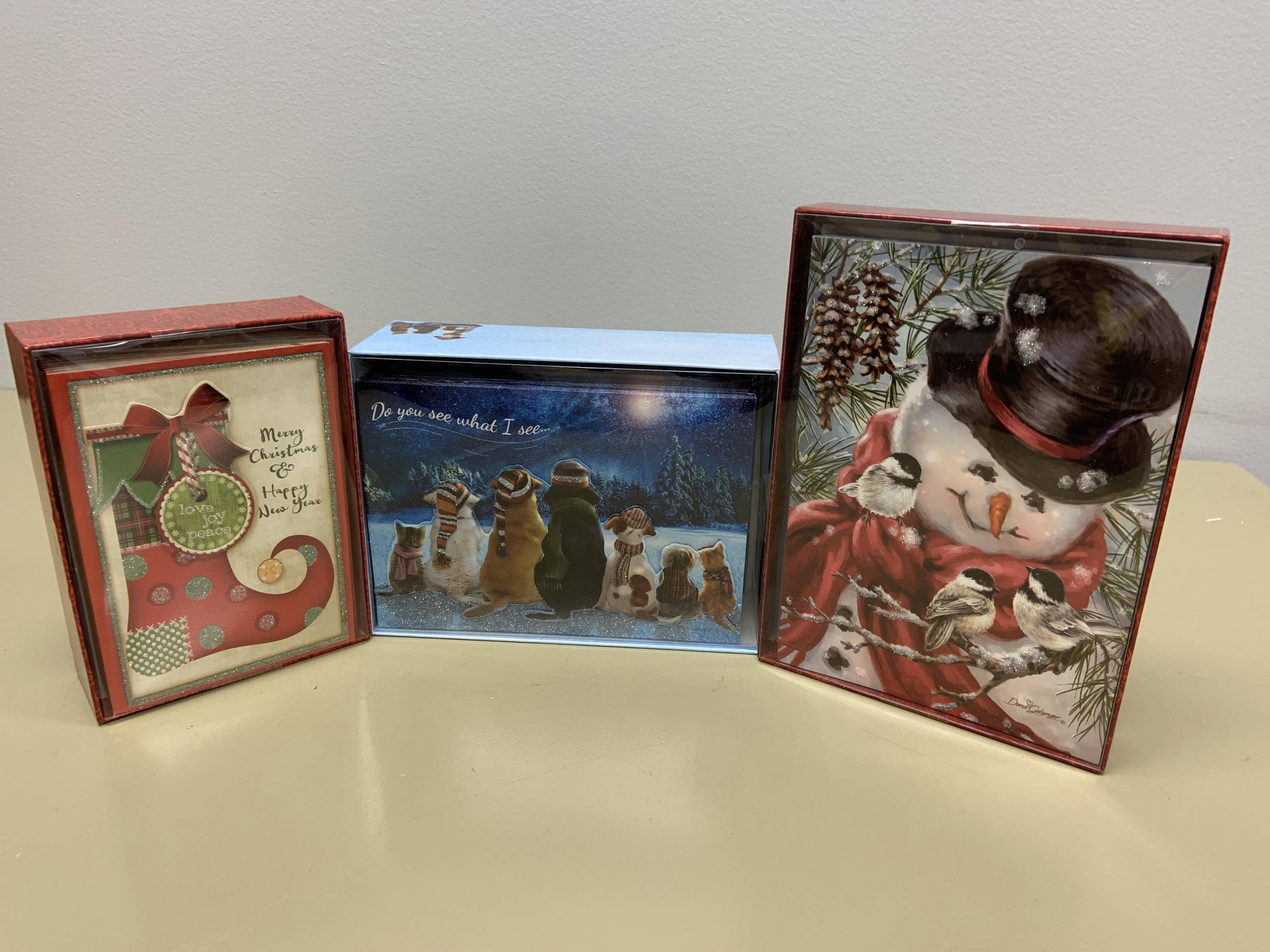 boxed christmas cards stocking, snowman with birds and waiting for santa