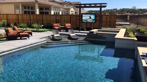 Outdoor TV enclosure by a pool