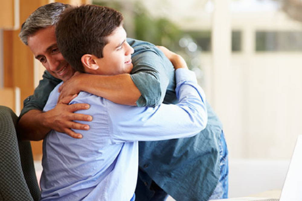 father and son embrace