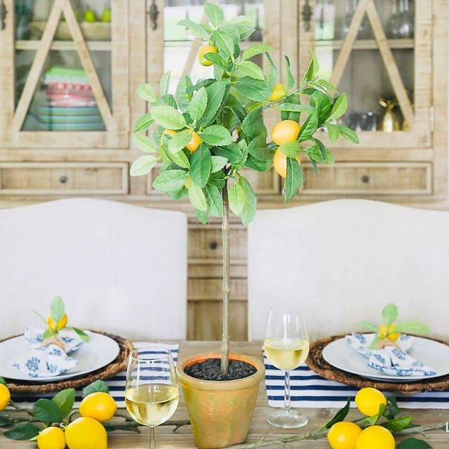 An artificial lemon tree from Nearly Natural decorated on a dinner table