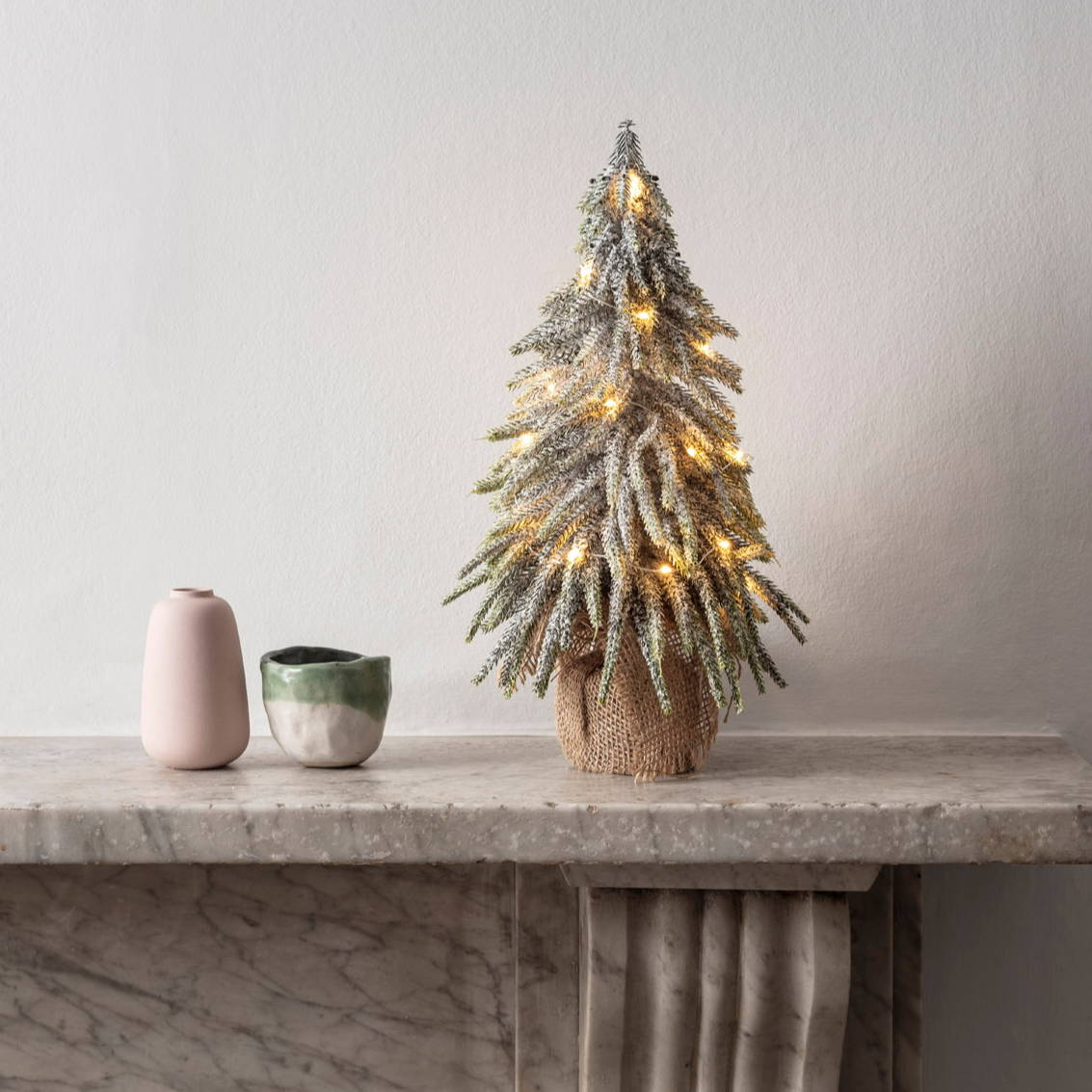 Pre Lit Mini Christmas Tree on a mantelpiece