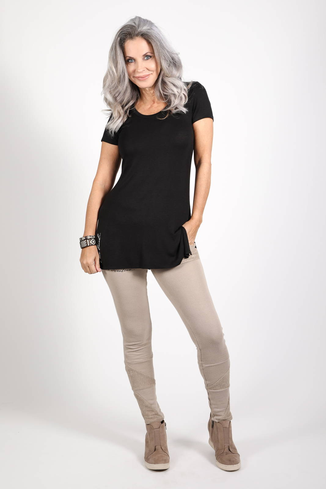 Model wearing the Dawl Tunic in black and the Ciana Terry Jogger in Light Tan