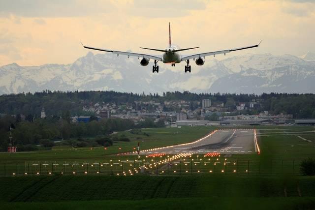 A Plane Landing On A Runway
