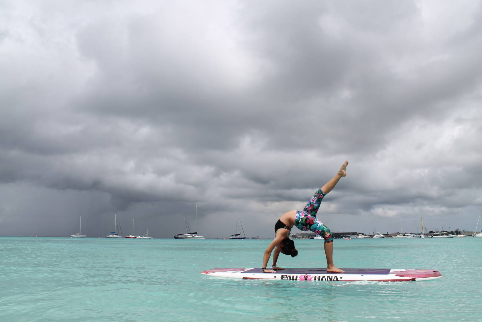 tropical waters doing yoga moves