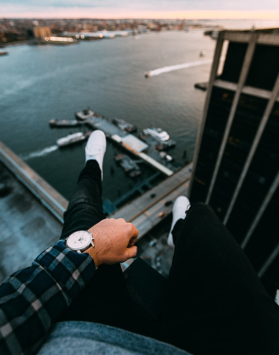 first person wrist shot of man looking at harbor