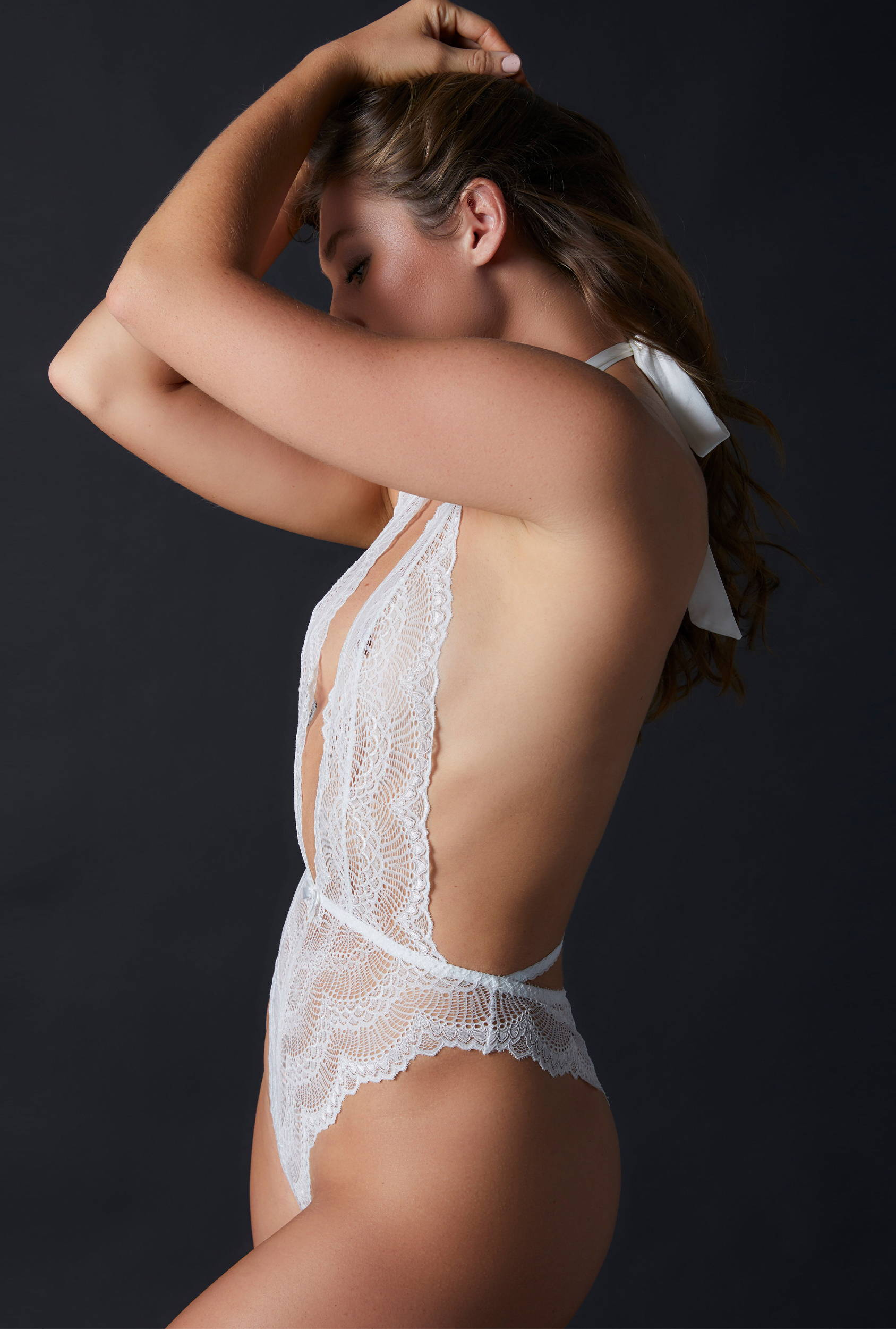 Woman wearing the best-selling favorite lingerie bodysuit - the Journelle Natalia