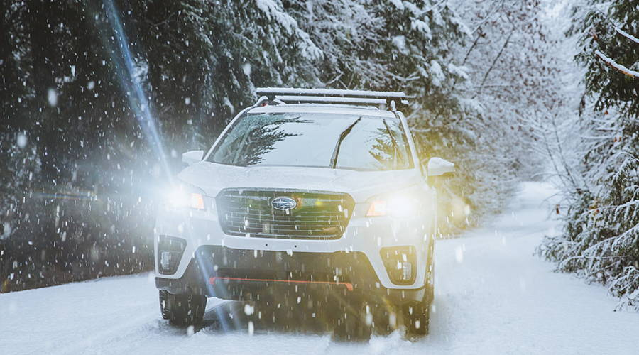 2019 Subaru Forester Sport driving through a snowy road on the way to our destination