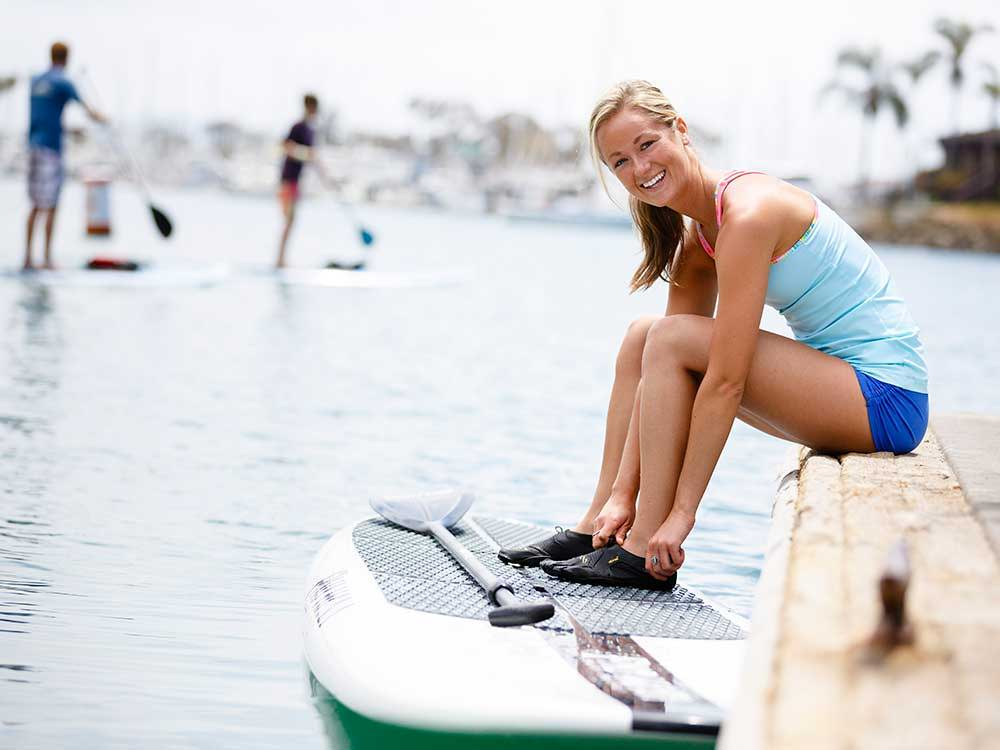 Having fun on the durable Pau Hana Big EZ Ricochet paddle board