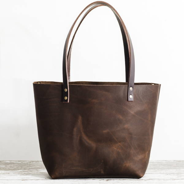 d2897e439c Grizzly Tote. Sold out  120.00  240.00. Shop More. Handmade leather Merlot  Makeup bag
