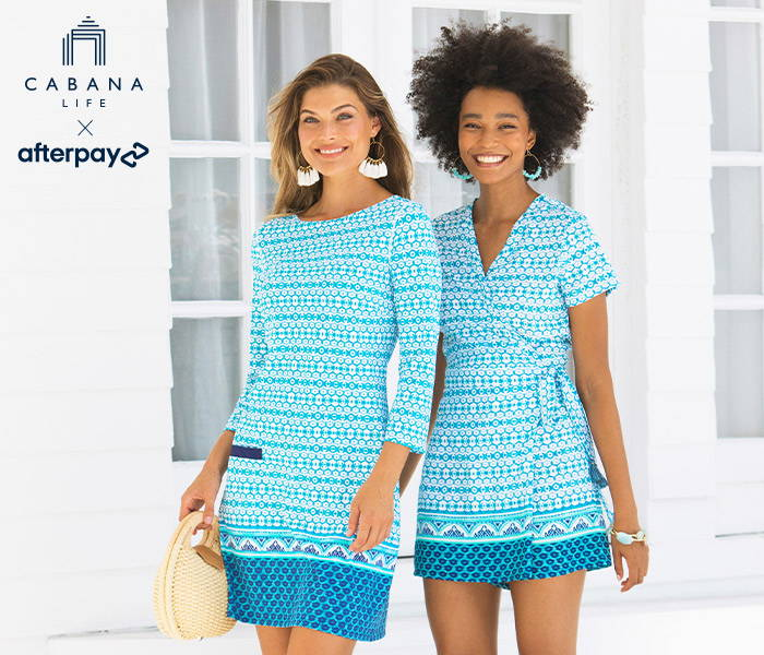 Woman wearing Aruba Blues Cabana Shift Dress & woman wearing Aruba Blues Tassel Wrap Romper