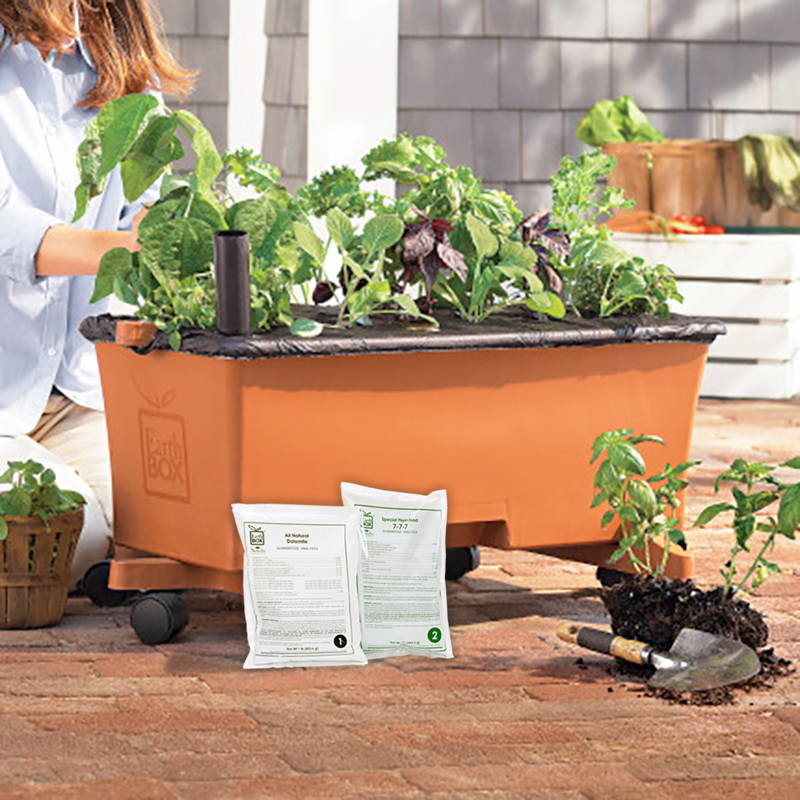 Woman replanting her EarthBox using the EarthBox Replant Kit