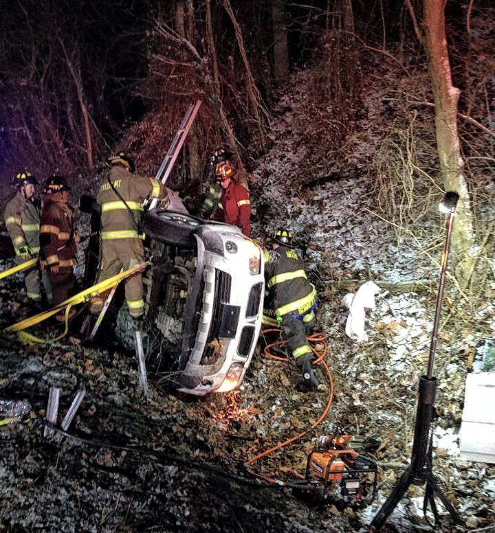Firefighters use the Nomad Prime in a car accident on a rural wooded roadway.
