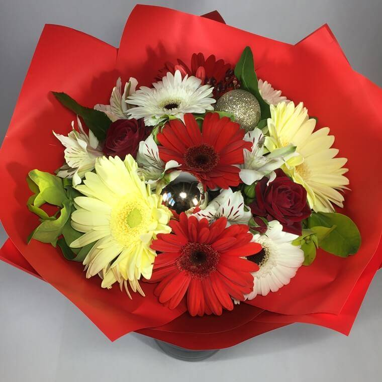 Festive gerberas and assorted flowers for delivery