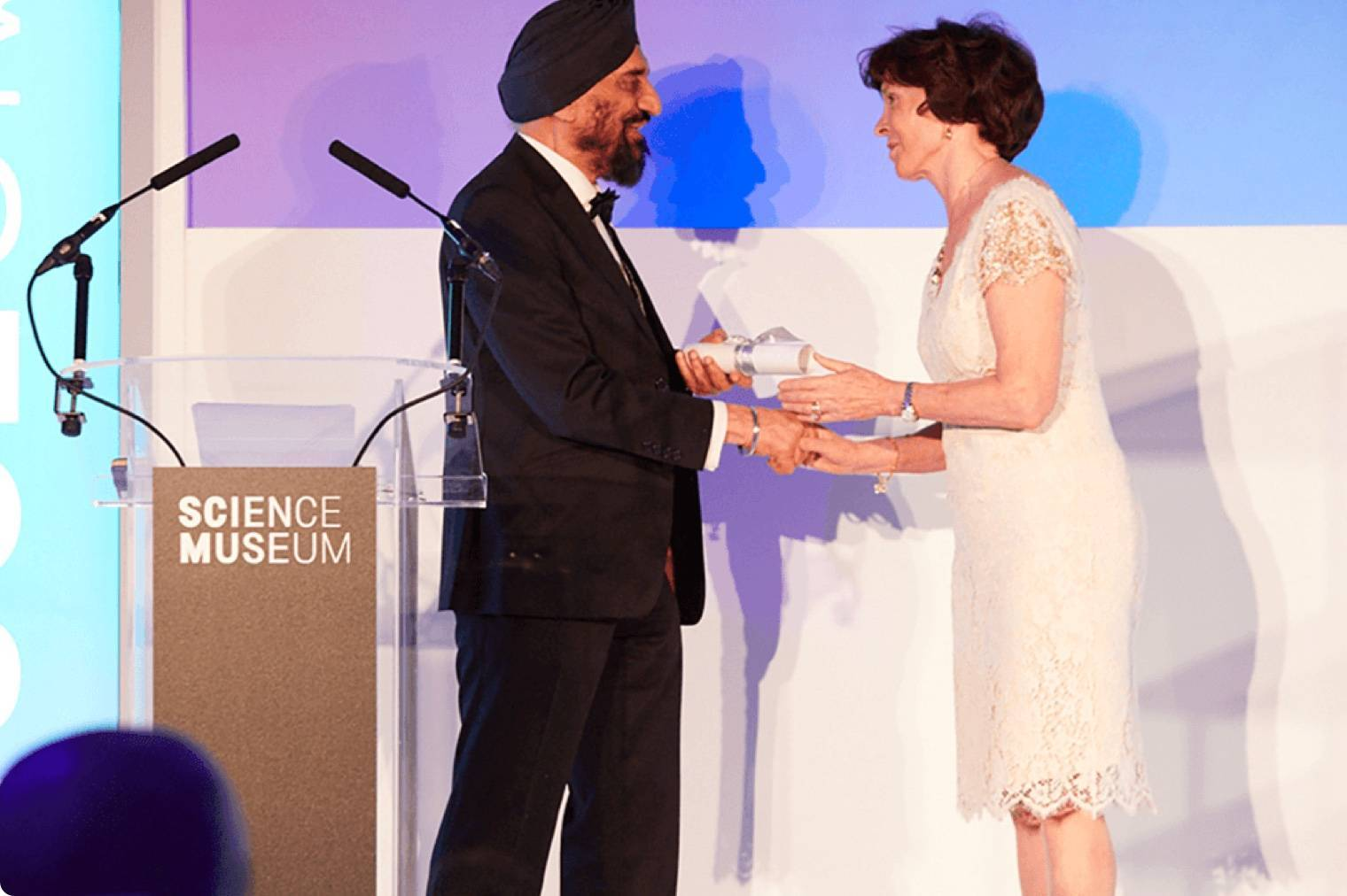Professor Kartar Lalvani Receiving Award