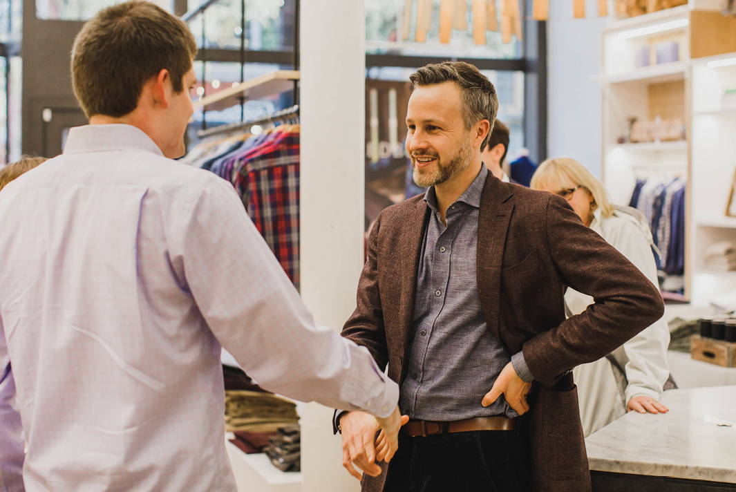 Ledbury's CEO Paul Trible shaking hands with a young adual from The Next Move Program