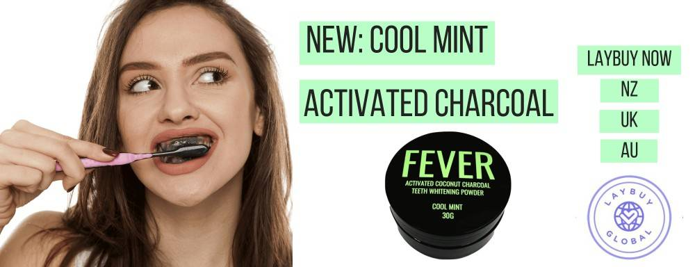girl brushing teeth with Cool mint activated charcoal powder