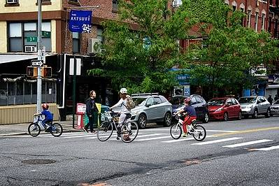 Bicycles using crosswalk in neighborhood