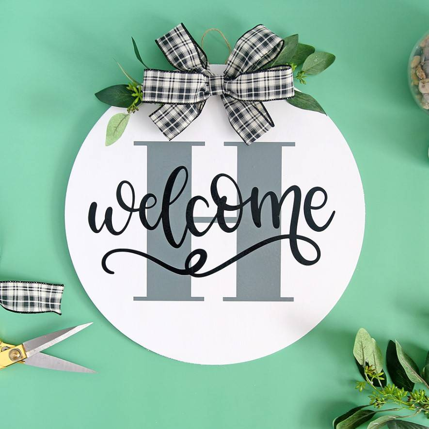 monogrammed welcome sign using craftables adhesive vinyl