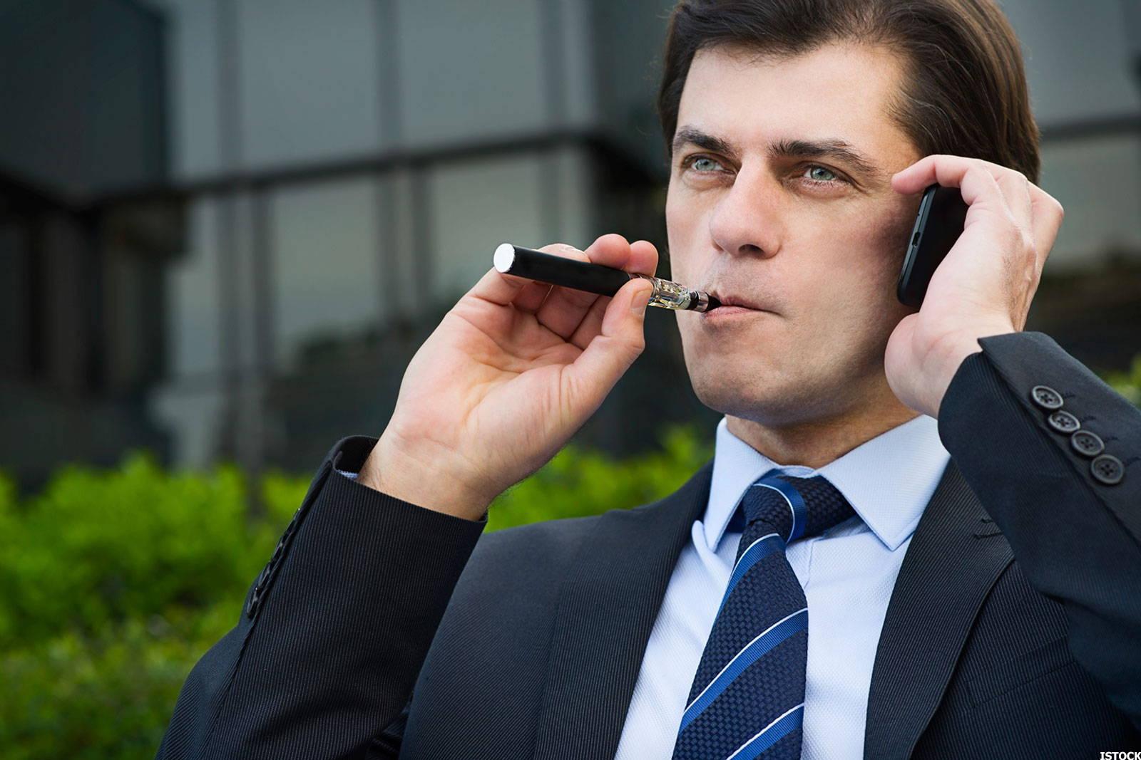Executive smoking a vape pen