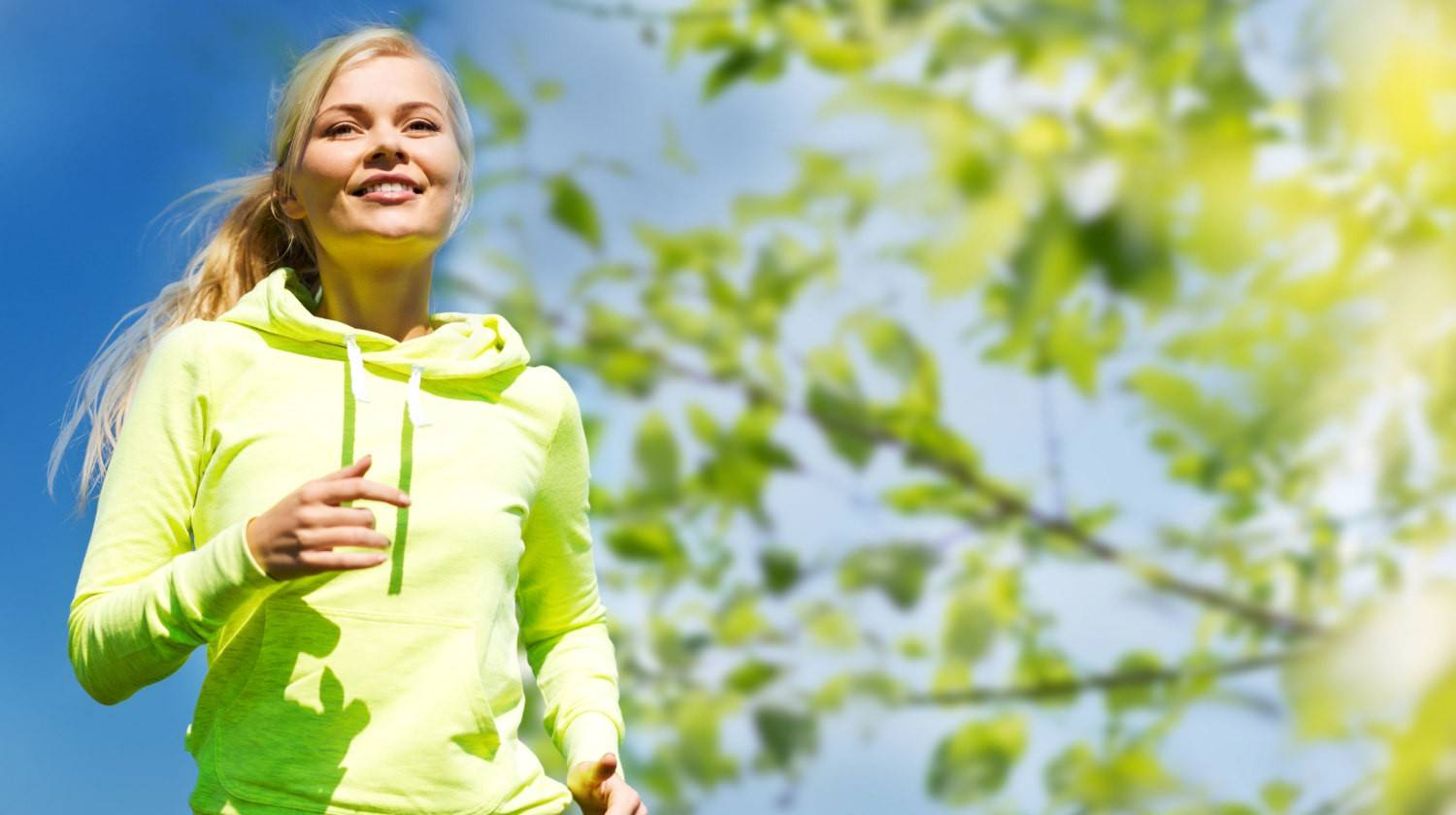 Happy young female runner jogging outdoors | Why Enzyme Supplementation Is Necessary for Most People | digestive enzymes | digestive enzymes benefits | Featured