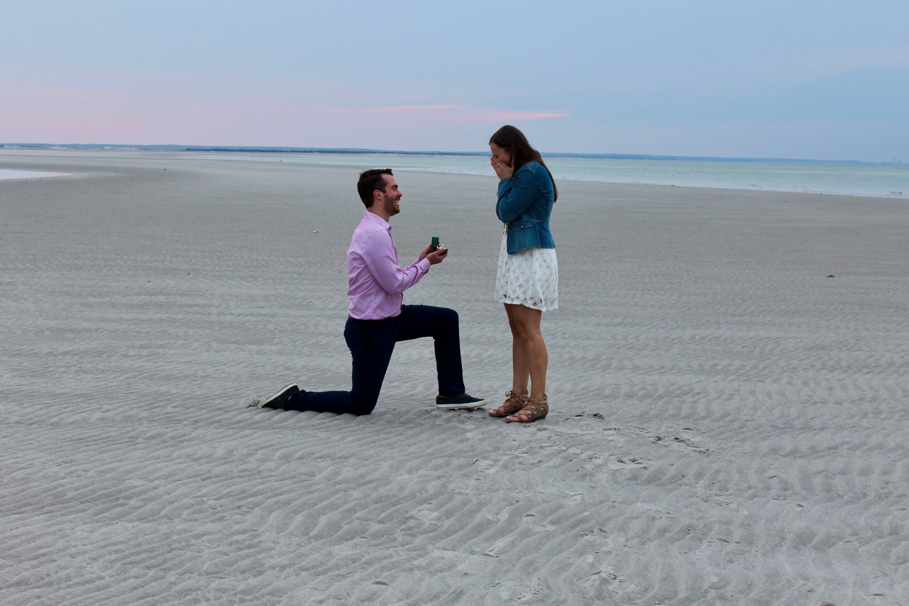 Luke Proposing to Taylor on the Beach with an Engagement Ring from Henne Jewelers