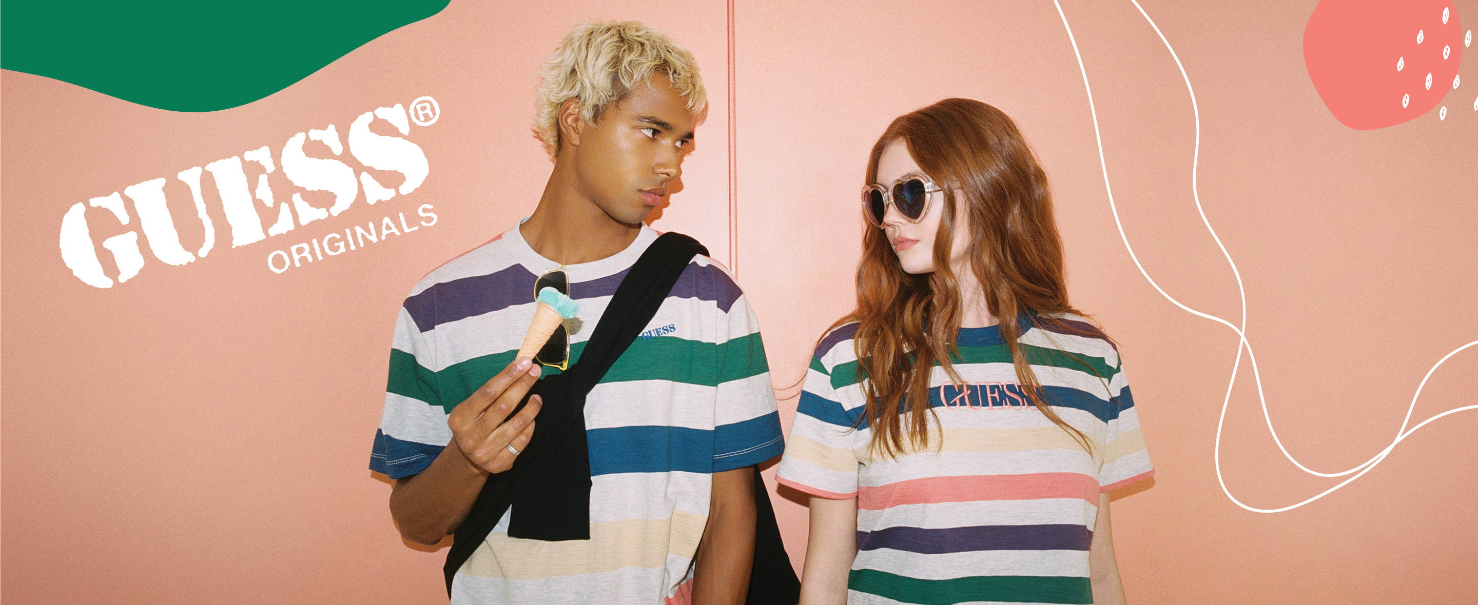 A couple wearing GUESS Originals collection clothing