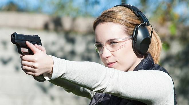 Woman shooting using Ruger LC9