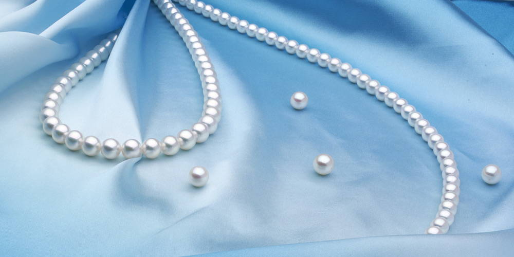 Akoya Pearls on Blue Silk by Pure Pearls