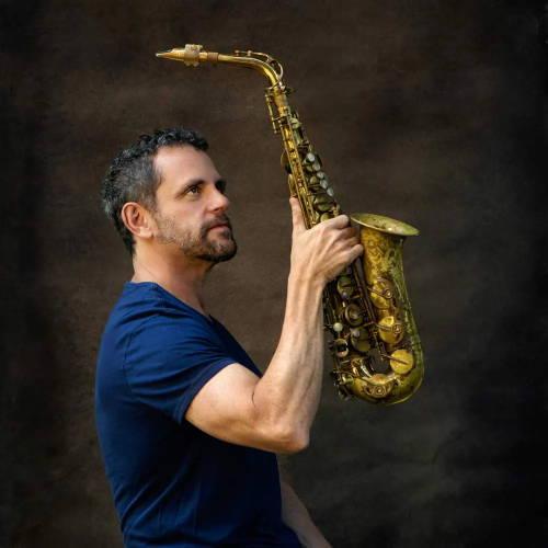 Andy Snitzer holding. amark VI alto saxophone