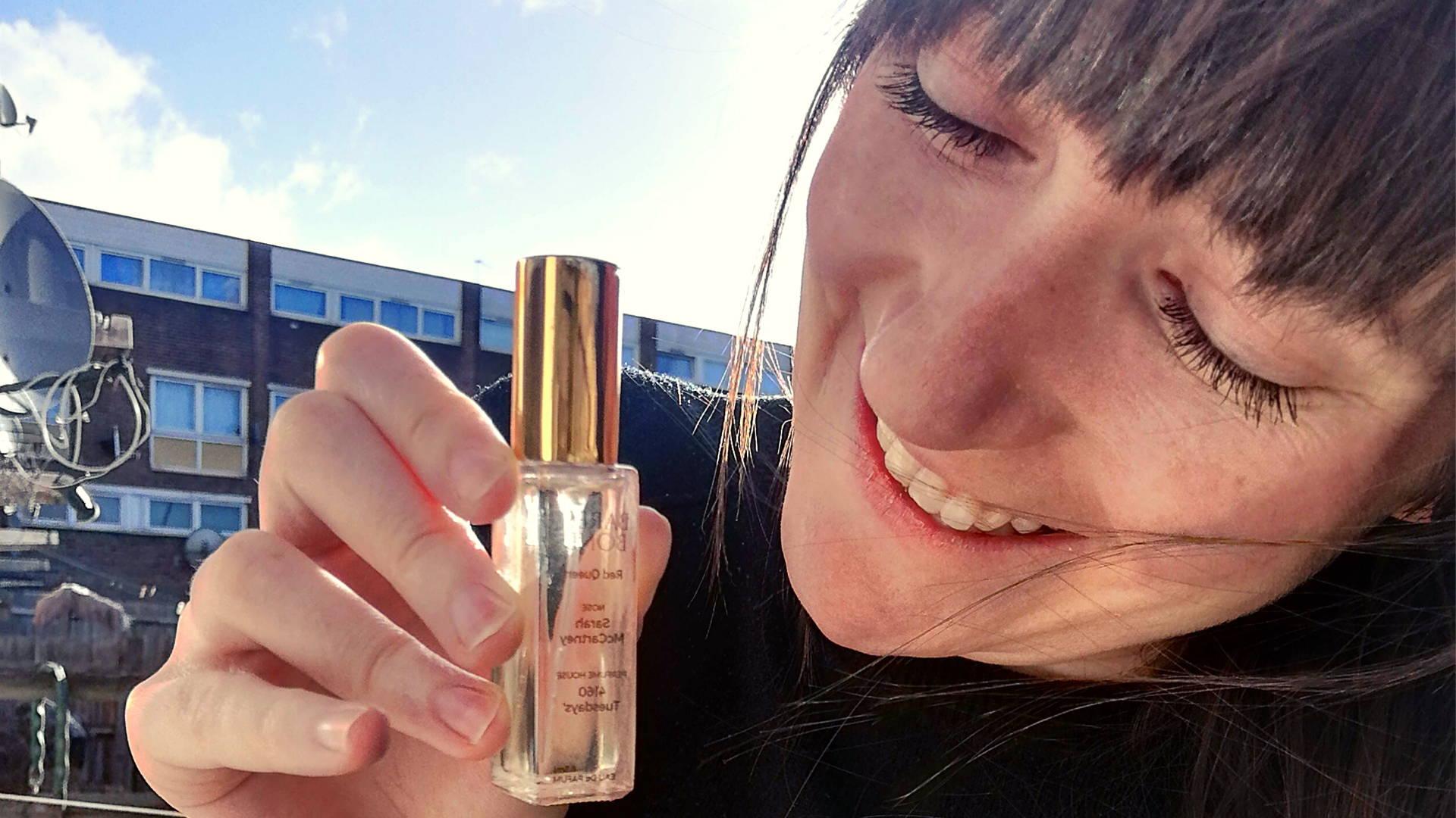 Frankee holding Bare & Bond perfume bottle