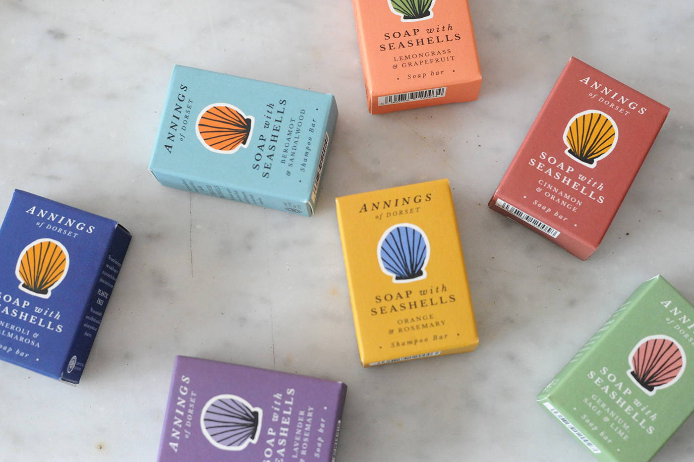 A scattered picture of Annings soaps in their colourful packaging.
