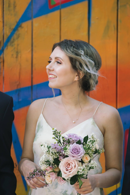 Bridesmaid holding a bridesmaid bouquet in Toronto