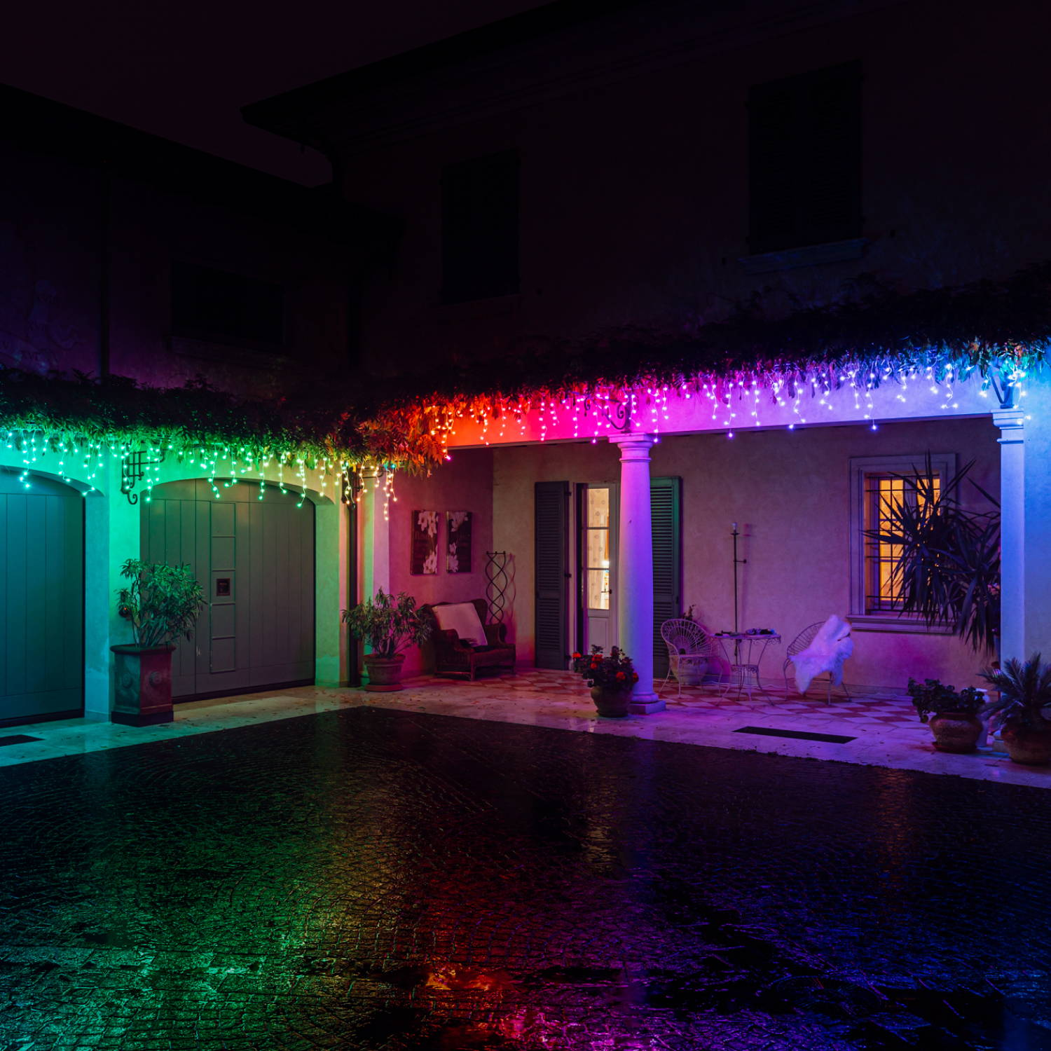 Multi coloured Twinkly icicle lights displayed along roof edge
