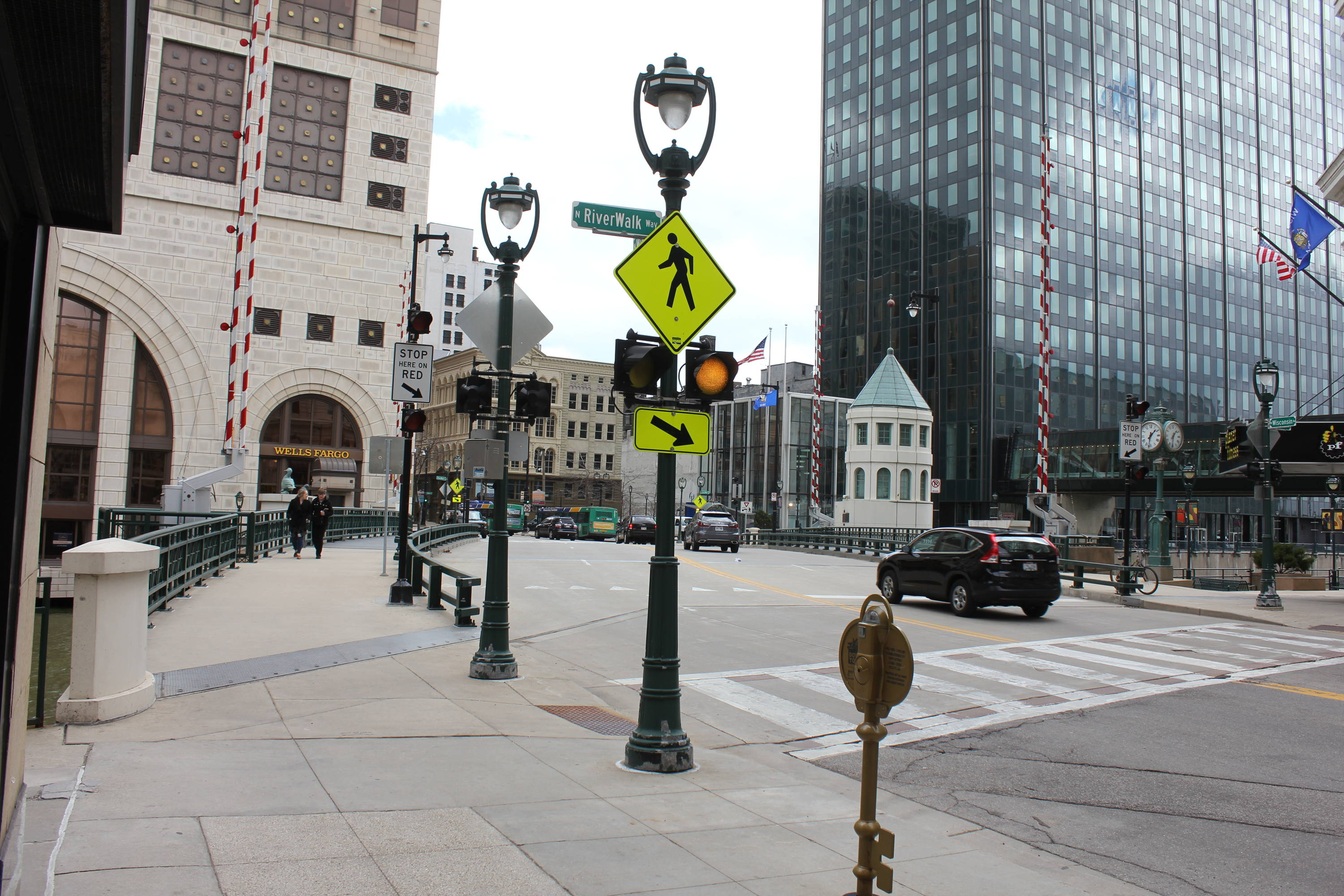 A heavily trafficked pedestrian crossing is enhanced by flashing LED beacon.