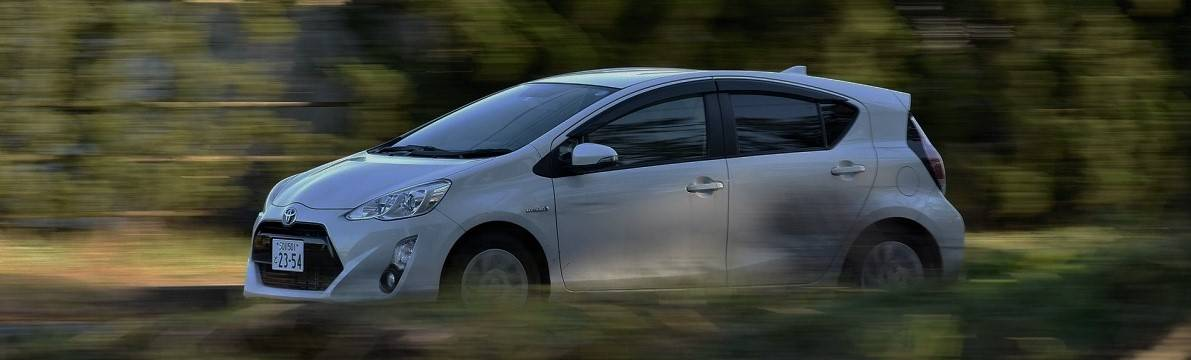 A Toyota Hybrid car driving through the countryside at speed
