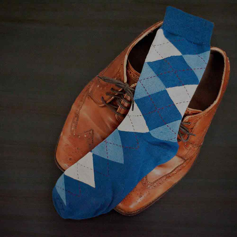 Steel blue argyle socks paired with brown leather shoes