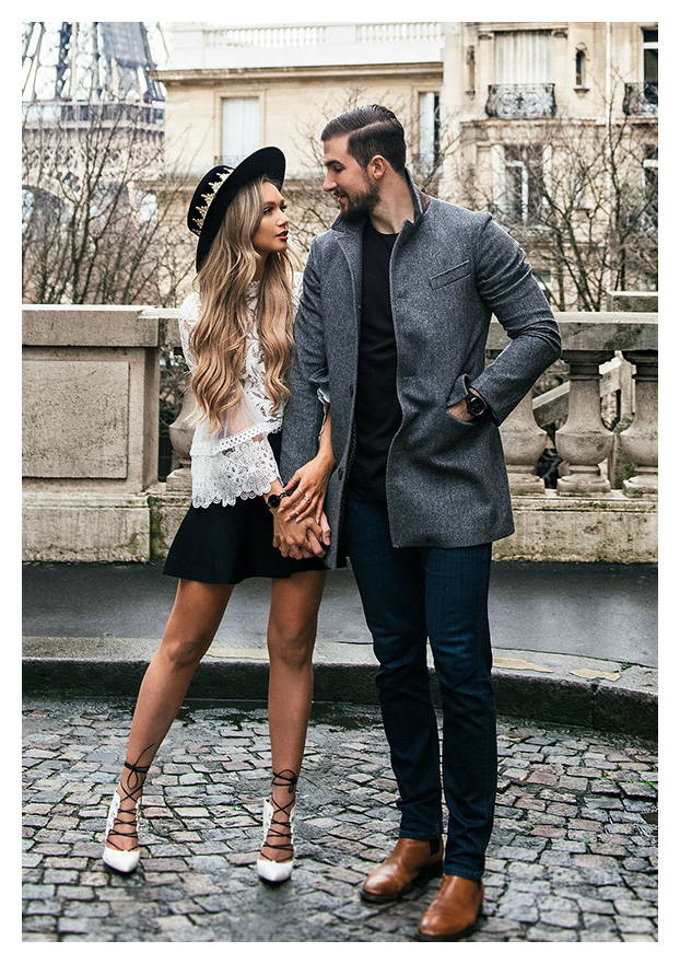 fashionable couple holding hands in paris