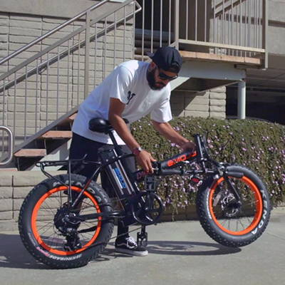 Folding an Emojo Lynx Pro electric bicycle.