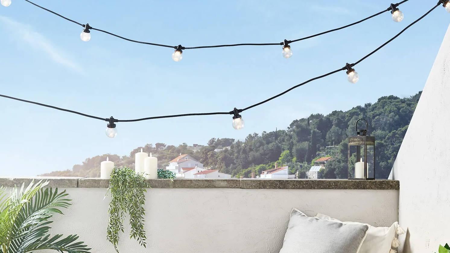 Warm white festoons hung above balcony