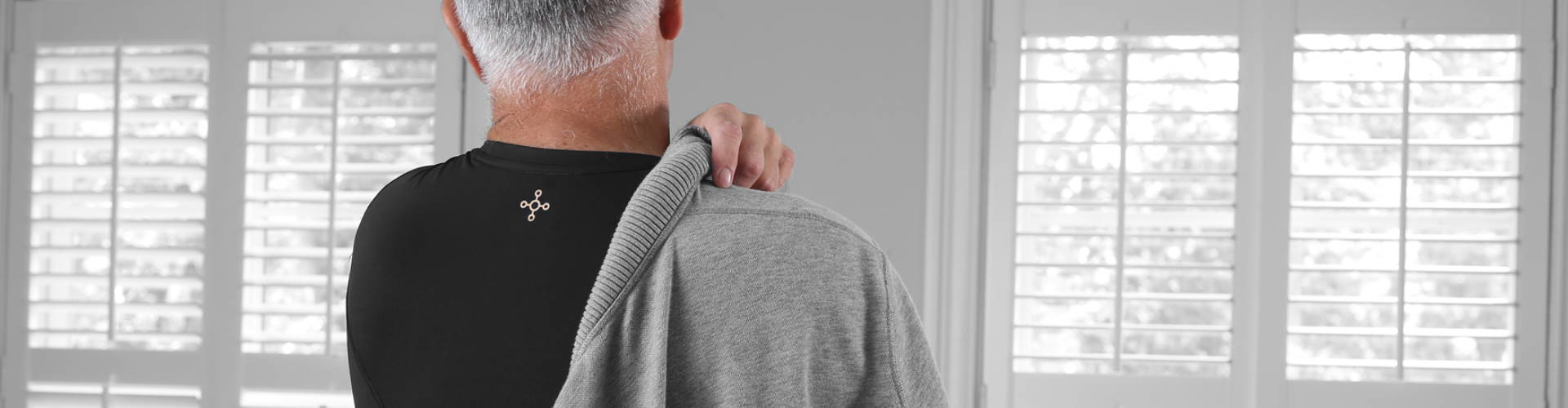 Man wearing a Tommie Copper® shoulder support shirt