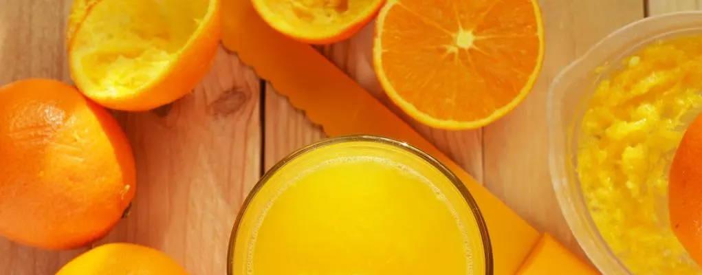 Oranges being juiced