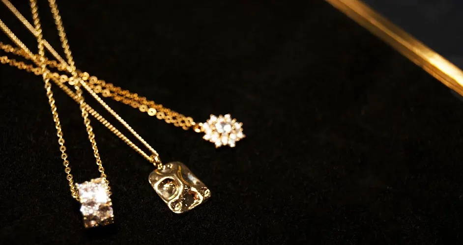 gold cz diamond pendant necklaces on black background