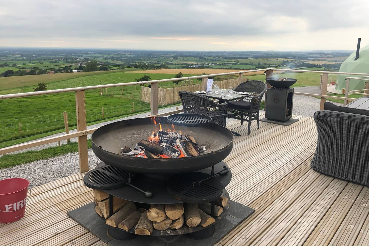 Fire Pit On Decking In The Countryside