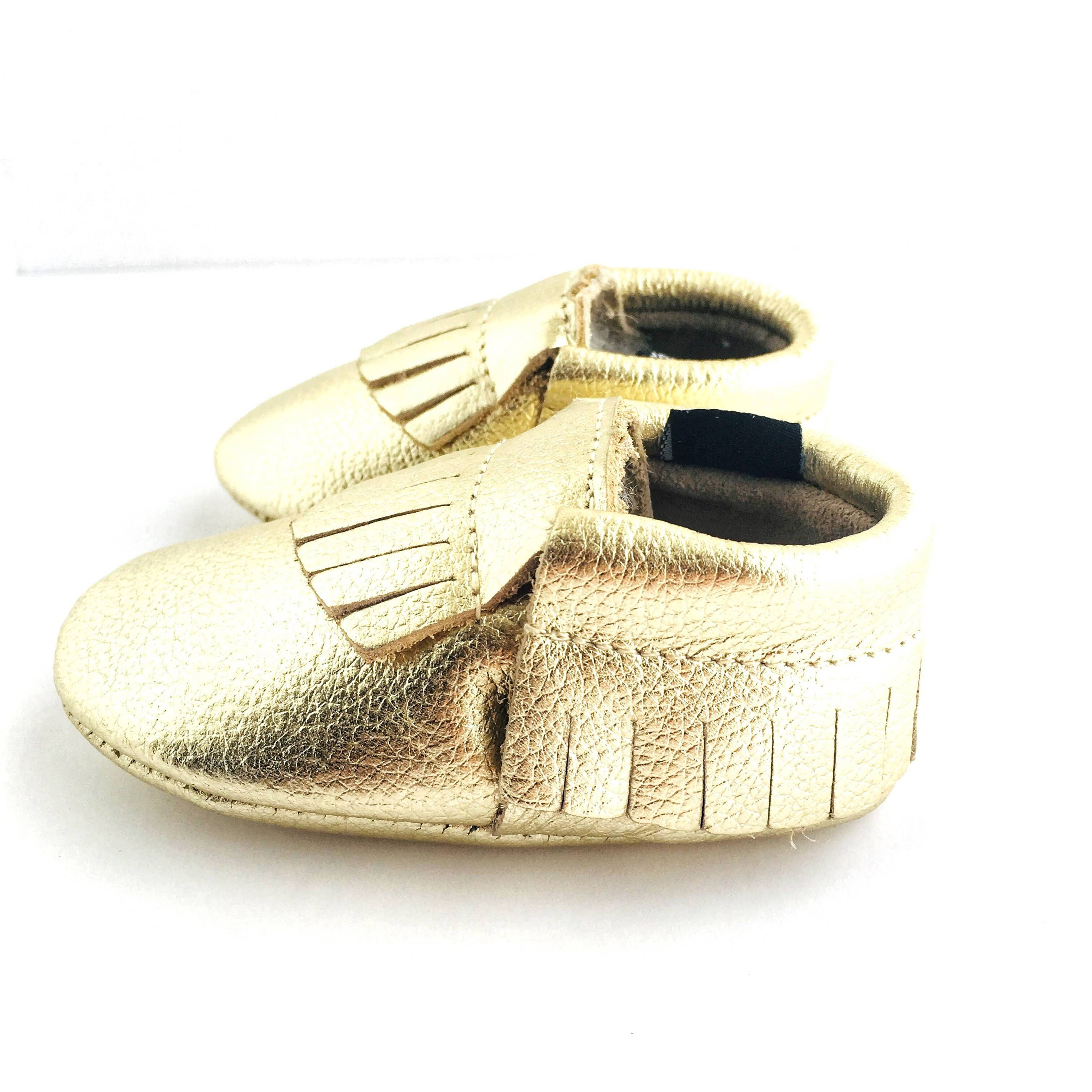 Metallic Gold colour soft sole shoes with fringe sole view