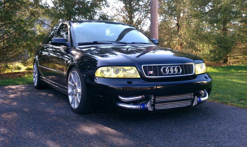 Audi with Yellow Lamin-x headlight tint film covers