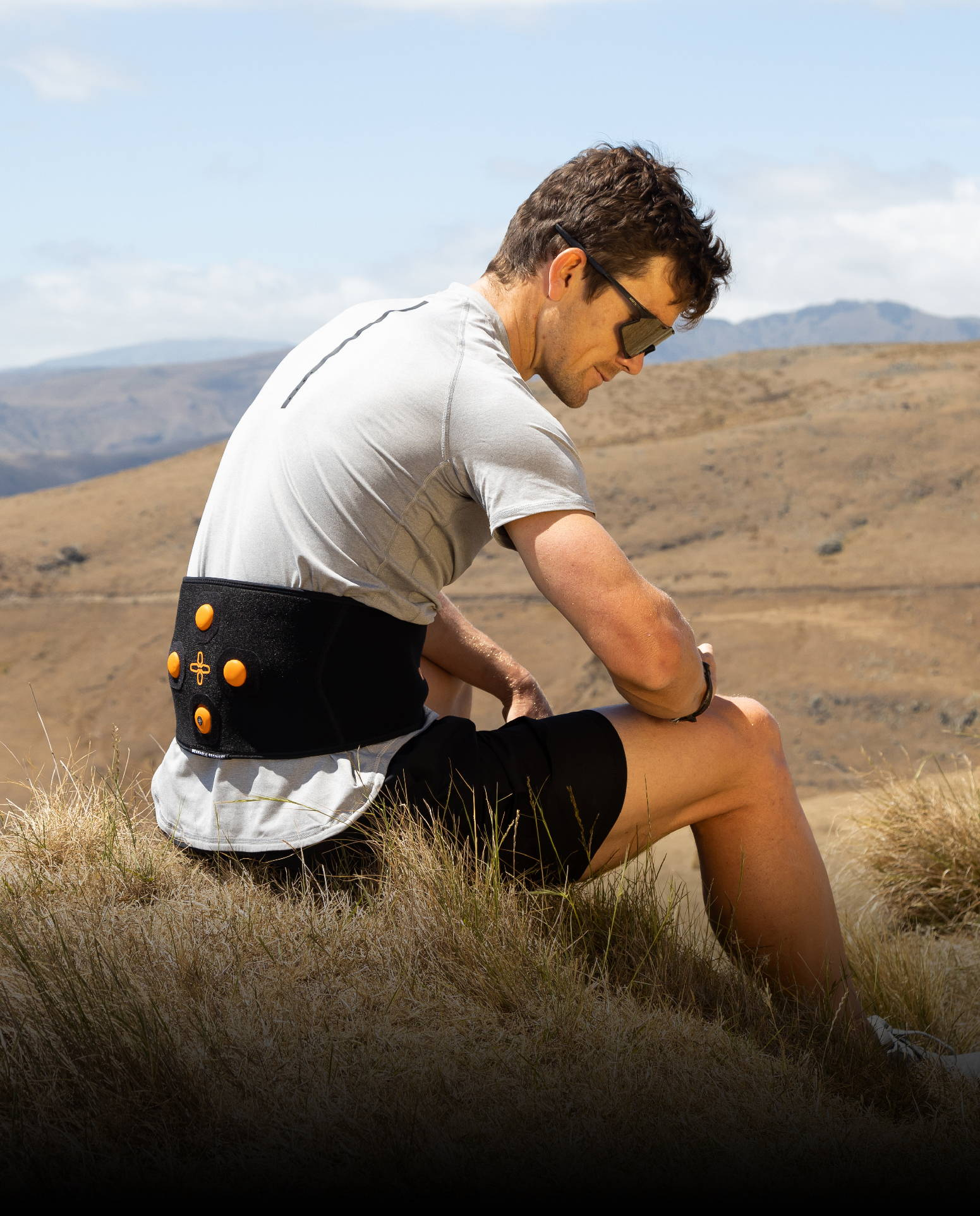 Mike Phillips taking a break on a hill wearing Myovolt Back